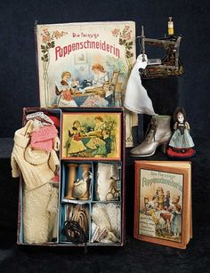 "German children's sewing box ""Die Fleissige Puppenschneiderin"" (The Industrious Dolls-Dressmaker) with lithograph of children sewing for their dolls on the lid; toy sewing machine; ""Puppenmütterchens Nähschule"" (Little-Doll-Mother's Sewing School) book with cover scene of children sewing for their dolls and containing patterns for doll costumes; a small bisque head doll in original folk costume on pincushion base; and a cast metal shoe pincushion. Germany, circa 1890."