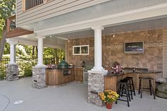 gutter system under a screen porch outdoor ktichen How to Use the Space Under Your Deck