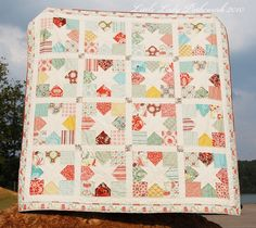 We love the originality and synergy of the block patterns in this quilt!  This was originally designed by Stefanie Roman of Little Lady Patchwork for the Moda Bakeshop as one of their many featured quilt projects.  You probably won't have much luck finding the charm pack Stefanie used (Fandango), but Moda offers so many wonderful alternatives! http://www.freequiltpatterns.info/free-tutorial---charming-stars-quilt-by-stefanie.htm