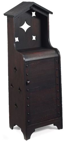 """SHOP OF THE CRAFTERS Arts and Crafts cellarette, unusual form with a peaked top and cut-outs at back above a single door, pierced design at sides, unsigned, refinished, 18.5""""w x 14""""d x 53""""h"""