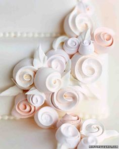 Swiss Meringue Ribbon Roses.. for Wedding Cake.  These would look very pretty on top of a pavlova cake and also taste delicious! 4 large egg whites    1 cup sugar    1 tablespoon meringue powder    1 teaspoon pure vanilla extract    1 one-ounce container each of peach, pink, and ivory food color paste