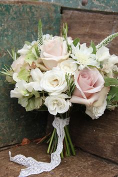 Pretty pastel wedding bouquets made with roses, sweet peas, veronica and hydrangea.