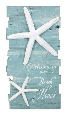 """Make any home your beach house with coastal decor. The """"Welcome to Our Beach House"""" sign features a distressed blue finish and dimensional starfish accents. Dimensions: 39.5""""h x 21""""w x .5"""""""