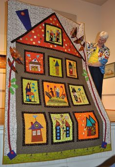 Not at all the kind of house we want, but one example of a big house quilt ... May be something like what we want to do on the back ...