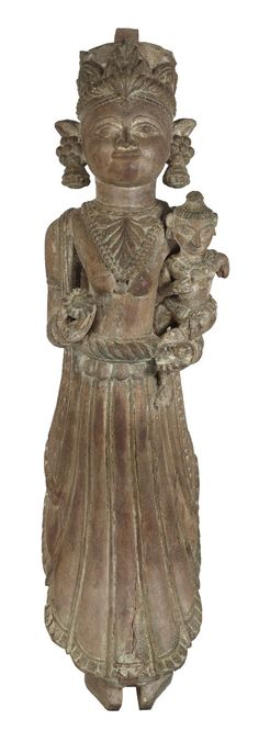 This female figure once adorned an interior pillar as strut in a palatial mansion of #Gujarat. The image carved in wood is shown with a child in her left hand with her palm open and a flower in her right hand.  The winged figure probably has been carved as an #apsara, the divine dancer and musician of Indian Mythology.#Gujarat, #19thCentury