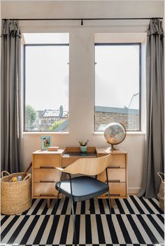 Interior Design & styling by Imperfect Interiors at this converted Victorian Dairy in East Dulwich, London SE22. Washed linen curtains, steel framed windows, a vintage mid-century Stag desk and Robin Day chair in the childs bedroom. www.imperfectinteriors.co.ukPhotos by Chris Snook