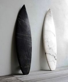 black and white marble surfboard sculptures