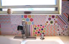 Scrap-book back-splash for craft room, so cute!! I'm thinking also pictures of friends family and or inspirations.