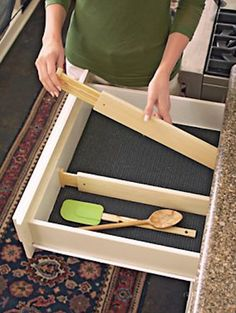 50 Useful Kitchen Gadgets You Didn't Know Existed---I've been known to spend hours in the aisles of the Container Store. I can't help it if I like every nook and cranny in my home to be well organized! I bought a few of these adjustable drawer dividers for my kitchen drawers, and I love them! You can completely customize the size of each slot.