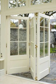 bi-fold doors @ Home Decor Ideas Thinking about something like this in basement to cover furnace and water heater, frosted glass windows with light behind it that folds out when you need access to them.