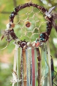 Cool boho spin on a dream catcher- grapevine, trinkets, ribbon