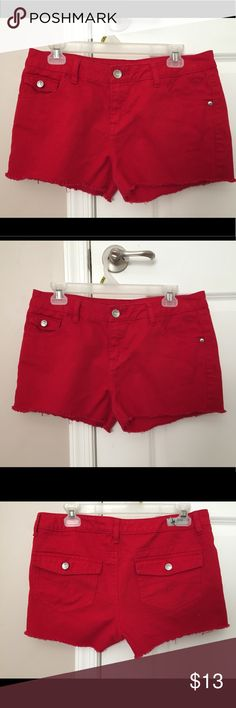 Bright red shorts These shorts are bright red and they are so cute on !! This used to be my favorite pair shorts but I grew up !! These shorts are A much brighter red in person !! And I  used to love wearing these shorts for the Fourth of July !! These shorts are size 16 1/2 for girls !! And have been barely worn !! Justice Bottoms Shorts