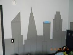 This is the finished Gotham City skyline with the detail lines drawn with a black Sharpie and the Wayne Industries sign attached with DIF wallcovering adhesive.