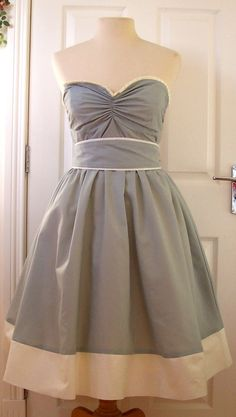 What a dress! Free sewing patern.  Would look great in a print!