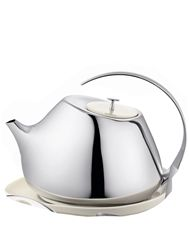 The new generation of Danish designers. Helena Rohner for Georg Jensen.  Polished stainless teapot with porcelain lid and saucer.  999 danish kroner.