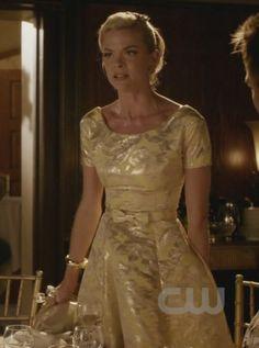 Lemon's gold cap sleeve dress with a bow on Hart of Dixie.  Outfit Details: https://wornontv.net/1188/ #HartofDixie