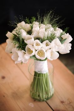 Lovely white tulip bouquet by Coquette Designs - Photo by Marian Dobrean Photography