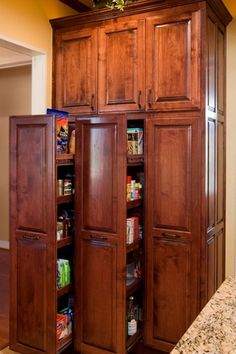 Traditional Pantry with travertine tile floors, Crown molding, KraftMaid Cabinetry Tall Pantry Pull-Out Cabinet
