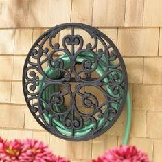 What a neat way to hide your garden hose.
