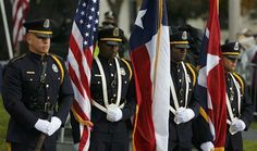 Members of a Dallas Police Department honor guard stand in Dealey Plaza during ceremonies marking the 50th anniversary of JFK's assassinatio...