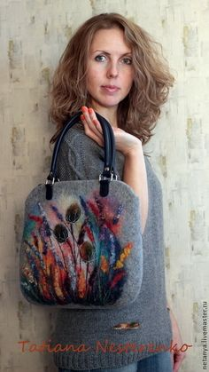 I like the shape of this bag and the handles