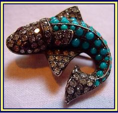 Antique fish brooch / pin made of gold set with diamonds, turquoises and rubies for eyes. 19th century.