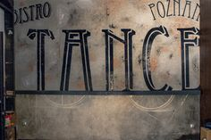 Ghost sign at Bistro Tancereczka, Poznan, Poland by Aleks Skrok