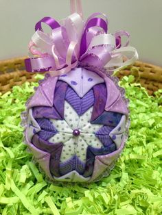 Set of 4 quilted easter placemats 270491061 easter eggs in pink folded fabric quilted easter egg in purples and lavenders with full bow by mulberrypatchquilts on etsy negle Gallery