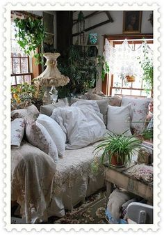 romantic cottage-  I love all the houseplants!  Makes it look more homey!  I must get more houseplants!