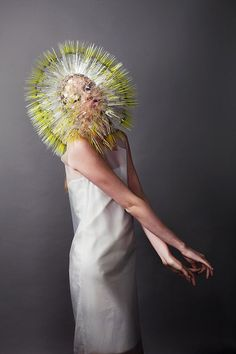 "The artist Maiko Takeda did the series ""Atmospheric Reentry"" in which he made very conceptual kind of bags and hats which have a bristled shape. The accessories made of plastic spikes were presented at the Royal College of Art fashion show. The photos are by Ayaki Kichikawa."