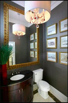 Using a mirror will expand the space to make it feel larger, helping create a luxurious powder room.
