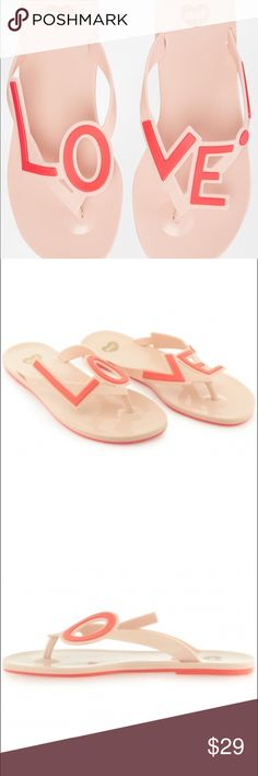 Mel dreamed by Melissa Love City pink flip flops LOVE CITY flip flops in pink. Worn only once. Love is all you need and with these women's casual sandals on, that's exactly what you'll have. These cute flip-flops have a glossy footbed made from the softest Melflex plastic for superior comfort and they're finished off with white oversized 'LOVE' wording on the vamp. Just try not to fall in love with these sandals. Melissa Shoes Sandals