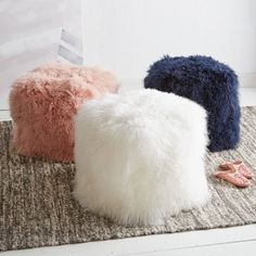 Blush, white and navy Mongolian lamb poufs from West Elm. West Elm, Puff Gigante, Girls Bedroom, Bedroom Decor, Bedrooms, Floor Pillows, Throw Pillows, Old Chairs, Lounge Chairs