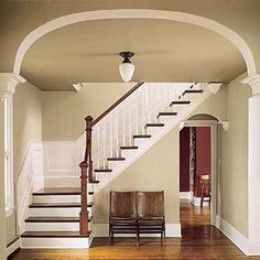 restored original staircase in Queen Anne. I like the panels on the walls up the stairway and the white/wood stairs.