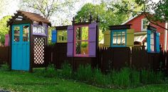 s 15 privacy fences that will turn your yard into a secluded oasis, curb appeal, fences, Create a fun design with doors windows