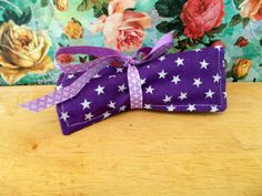 Check out this item in my Etsy shop https://www.etsy.com/uk/listing/269417957/purple-star-crayon-roll-pencil-roll