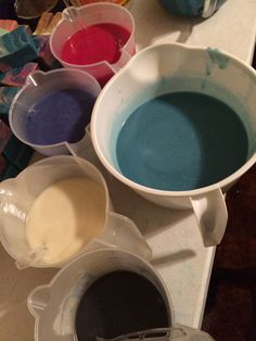 Here are the colors divided up and ready to go. It is not a super thin trace but fluid. I chose Cellini Blue from Bramble Berry for the base color, faux funnel pour colors are Klein Blue from nurture soap supply, Red Raspberry mica from BeScented, Black Oxide & TD white.