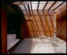 Bathroom of carter tucker house, showing natural light and materiality of space.