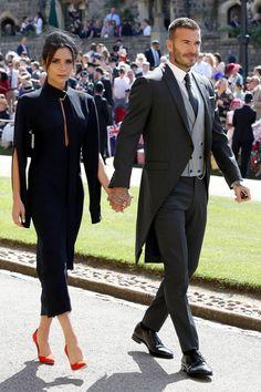 Victoria Beckham wearing Victoria Beckham. David Beckham wearing Dior Homme by Kim Jones.