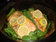 Jodi Orr's Crockpot Salmon, Really wanted some salmon for lunch so I am trying the crockpot recipe from the cookbook. Entire bag of fresh spinach, 1-2 pounds salmon seasoned with salt, pepper, and dill. Put salmon on top of spinach and top with lemon slices. Pour 1/4 cup low sodium chicken broth over top. cook on low for 2 hours or until salmon flakes apart. #24 Day Challenge Approved