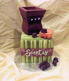 What a cool cake this is...love it!  Scentsy cake 1 by Cake Rhapsody, via Flickr