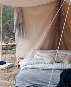 Dirt and bugs in your bed.  That's the reality of this dreamy setup.