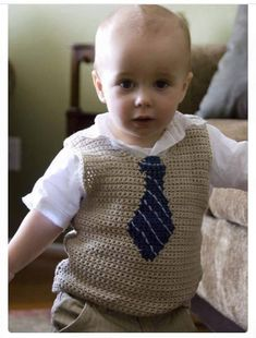 Ravelry: Little Man Vest pattern by Candi Jensen 32 Free Crochet Vest Patterns for Isn& this just a darling little vest? And the tie& built right in! This Pin was discovered by Gam For my future child ❤️❤️❤️ Crochet Baby Sweaters, Crochet Baby Clothes, Baby Knitting, Knit Crochet, Crochet Vests, Ravelry Crochet, Free Crochet, Crochet Cardigan, Knitting Needles