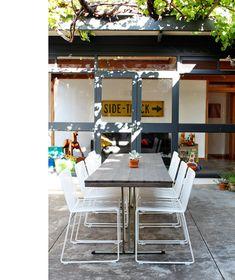 BrianParkes-courtyard - via design files    Alexander Loterzstain wire chairs - Stylecraft