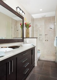 """Layout to redo the hall bath without moving any plumbing. Floor is slate-look tile, 24x24, cut into 12x24 and placed in herringbone pattern using contrast grout. Countertop is Caesarstone """"Concrete."""""""