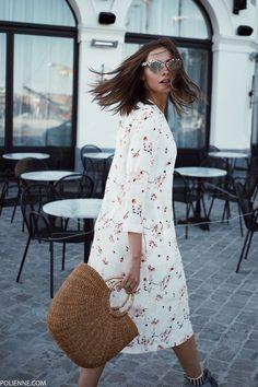 POLIENNE by Paulien Riemis | wearing a BELLEROSE floral dress, straw bag and REEBOK sneakers in Antwerp, Belgium