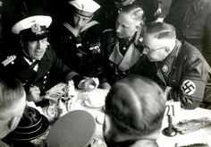 Heinrich Himmler and Reinhard Heydrich with sailors