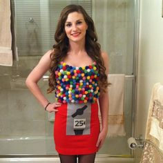 Costume gumball machine with pompoms and red skirt with appliqués.