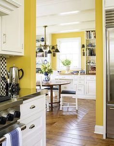 This modern kitchen uses the same yellow paint, Benjamin Moore's HC10, in both the kitchen area and the breakfast nook. For a similar look, you can also try Valspar Spring Squash 2008-1B (see next slide).   - HouseBeautiful.com