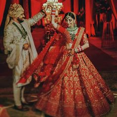 Can't keep up with wedding trends? Just stick to basics of red and green for your wedding. Outfits by Indian Bride And Groom, Bride Groom, Bridal Lehenga Images, Couple Wedding Dress, Indian Wedding Couple Photography, Indian Bridal Outfits, Bridal Photoshoot, Wedding Trends, Indian Weddings